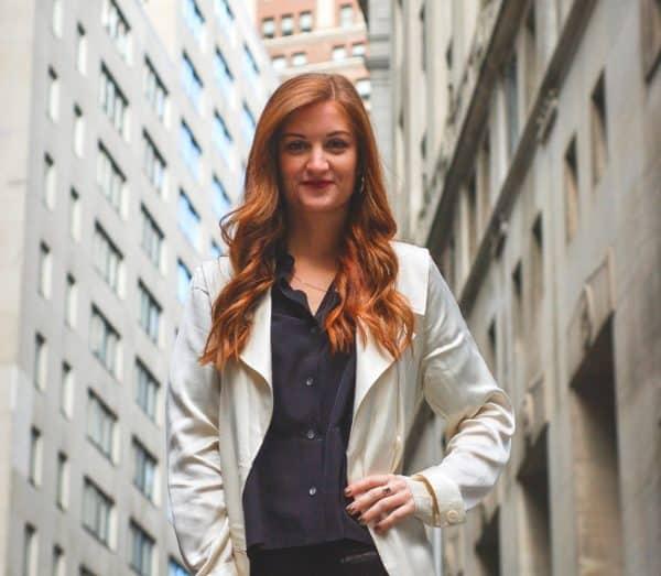 Woman standing on Wall Street