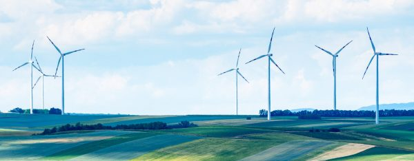 six windmills on the horizon exemplify clean energy and sustainable investing