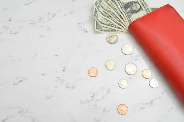 Red wallet with money sticking out to represent potential tax savings